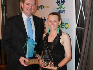 Landmark's Cameron Hall presents Gemma Lomax from Wellards with the Young Livestock Export Achiever Award.