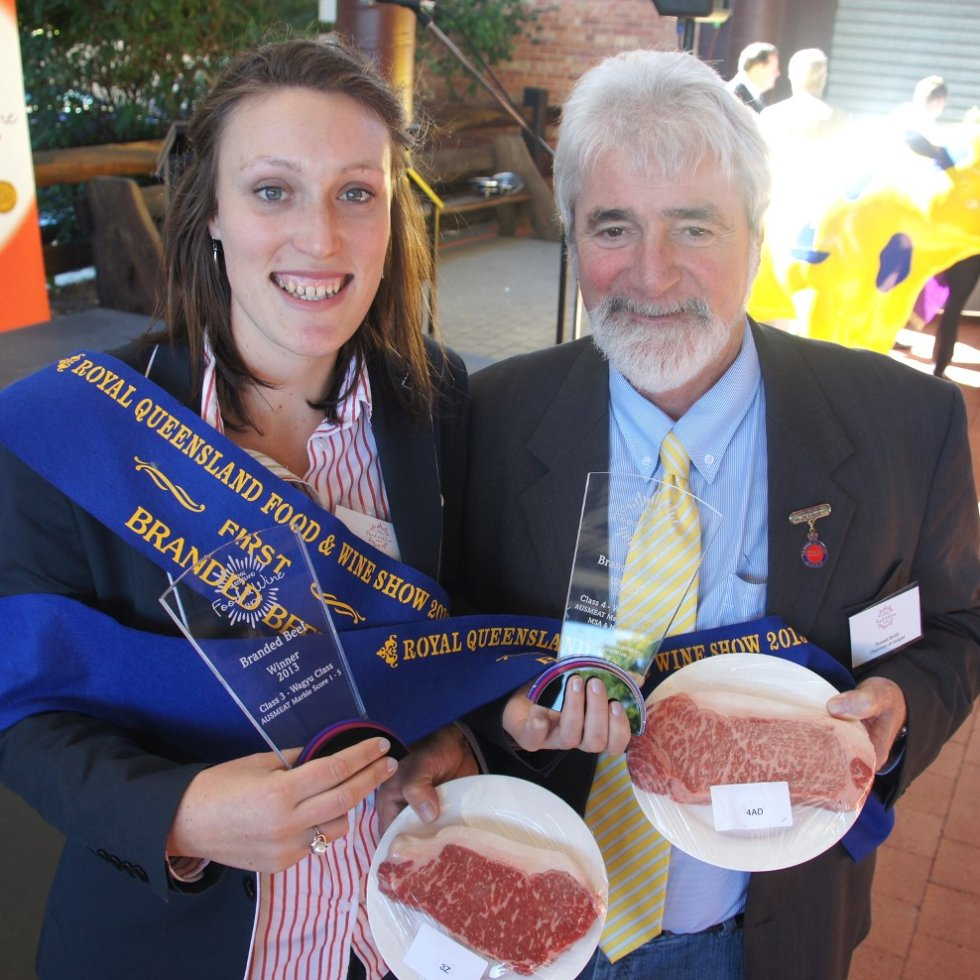 Andrews Meat Industries Kylie Schuller and head judge Russell Smith with the winning Tajima and Shiro Kin Wagyu samples at Friday's branded beef awards