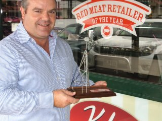 Kobe's Pete Cabassi with the 2011 RNA Red Meat Retail Innovation Award the business earned in August