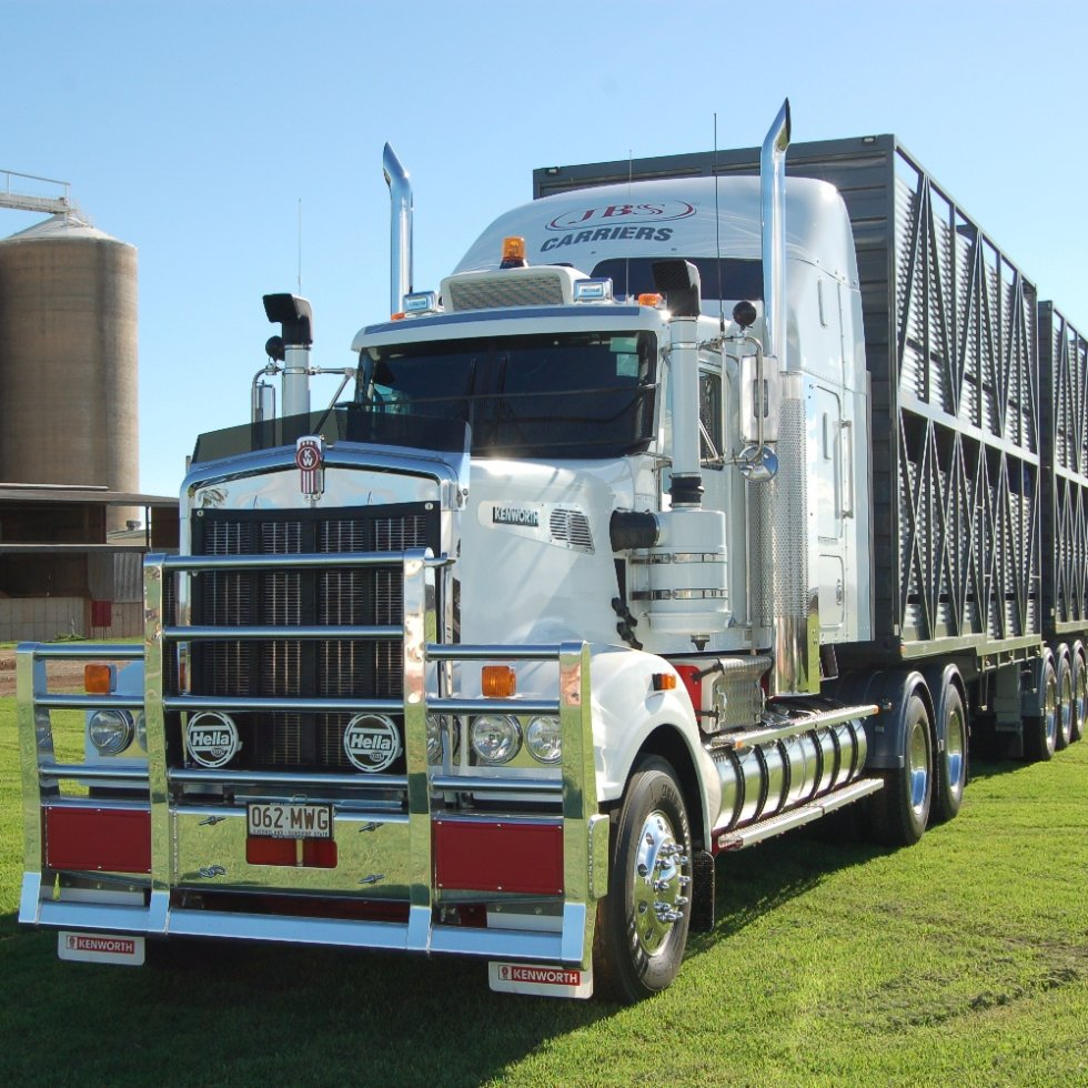 JBS Carriers prime mover beside the distinctive grain storage facility at Beef City feedlot