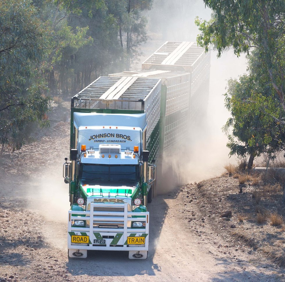 Johnson Bros Mack coming out of a creek crossing during a run in western Queensland