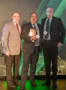 Smithfield Beef Co's Jason Sheaer-Smith accepts Woolowrths Livestock Supplier of the Year award from general manager, supermarkets, Pat McEntee and national beef procurement manager Brett Thompson.