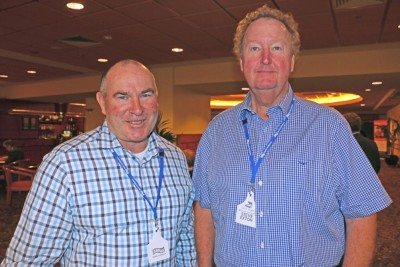 Woolworths Meat Company's Pat McEntee, left, catches up with Steve Exton, NSW DPI beef industry leader at Wagga, during the Angus Australia national conference at Albury yesterday