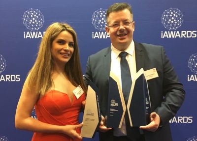 Automed principal David Edwards collects his company's awards at the recent iAwards in Canberra.