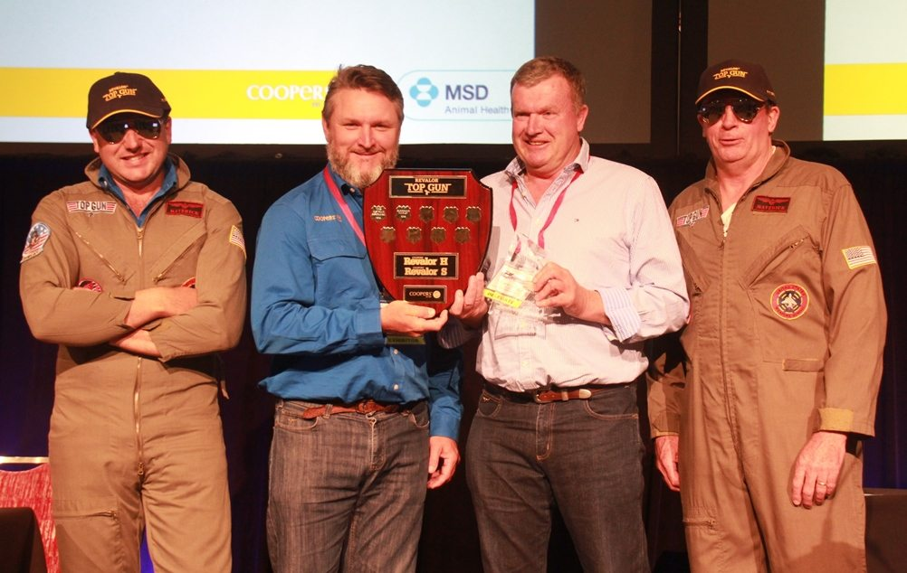 "Andrew Herbert accepts the 2016 Coopers Top Gun award on behalf of Gundamain feedlot's induction team from Coopers' Rob Baynes, flanked by the Coopers ""Top Guns"""