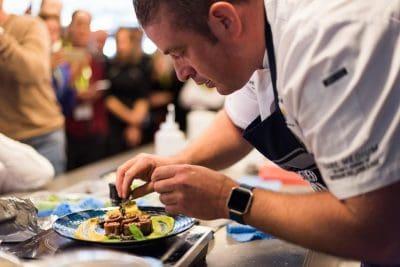 MLA executive chef Sam Burke plating-up
