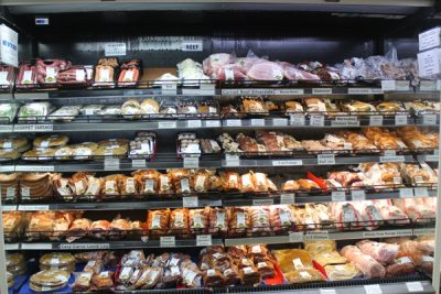 Packaged and processed meats on display in the deli section at Mondo Butchery