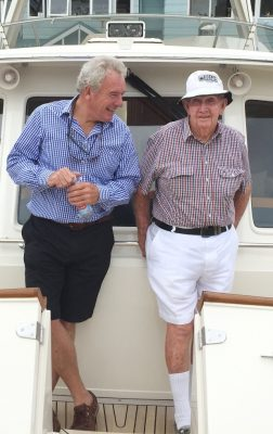 Leo Pugh with industry colleague Richard Rains in Richard's boat, Post Office. Leo loved his own boat, kept moored at Manly.